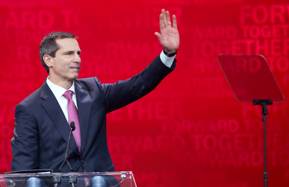 Premier Dalton McGuinty waves to the crowed while leaving the stage after speaking at the Ontario Liberal Leadership convention in Toronto on Friday, January 25, 2013. (Nathan Denette / THE CANADIAN PRESS)