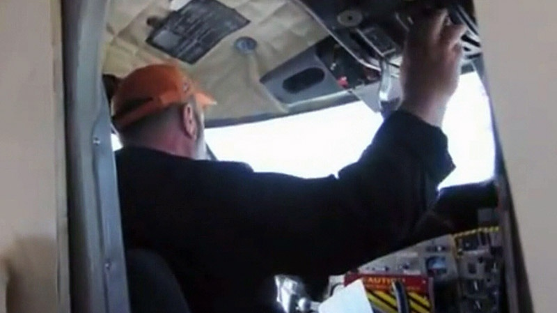 Pilot Bob Heath is shown preparing to fly a Twin Otter plane in this undated photo from video.