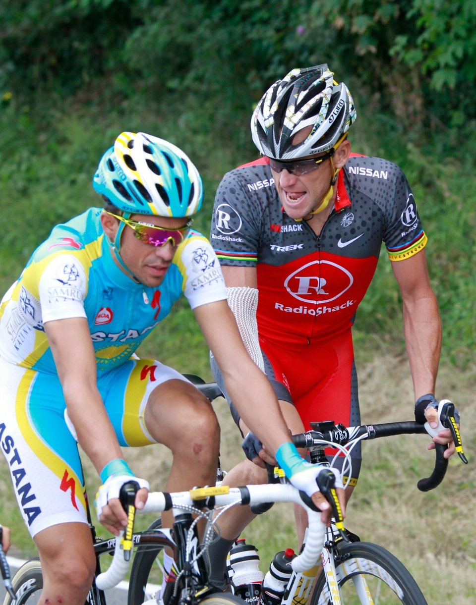Lance Armstrong, right, looks at his opponent Alberto Contador of Spain, as they ride during the third stage of the Tour de France cycling race in Arenberg, France in this July 6, 2010 file photo. (AP / Bas Czerwinski, File)