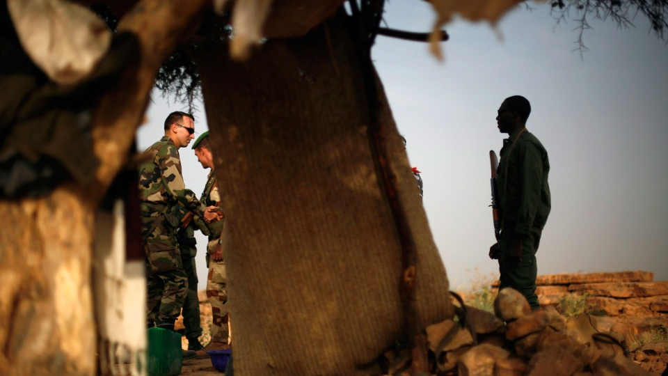 French soldiers met their malian counterparts at an observation post outside Sevare, some 620 kms (400 miles) north of Mali's capital Bamako Thursday, Jan. 24, 2013. (AP / Jerome Delay)