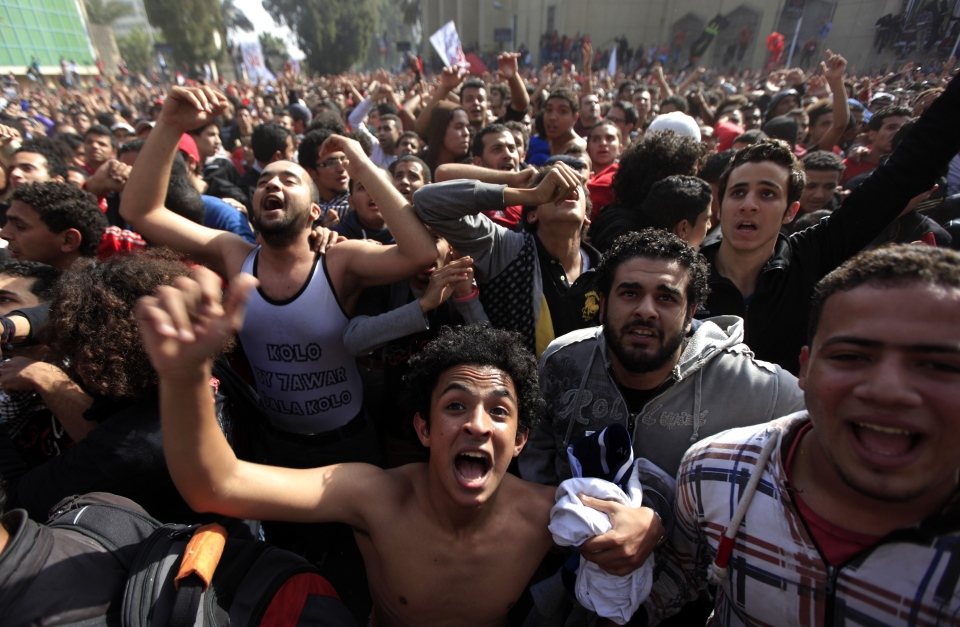 Egyptian soccer fans of Al-Ahly club celebrate a court verdict that returned 21 death penalties in last year's soccer violence, inside the club premises in Cairo, Egypt, Saturday, Jan. 26, 2013. (AP / Khalil Hamra)