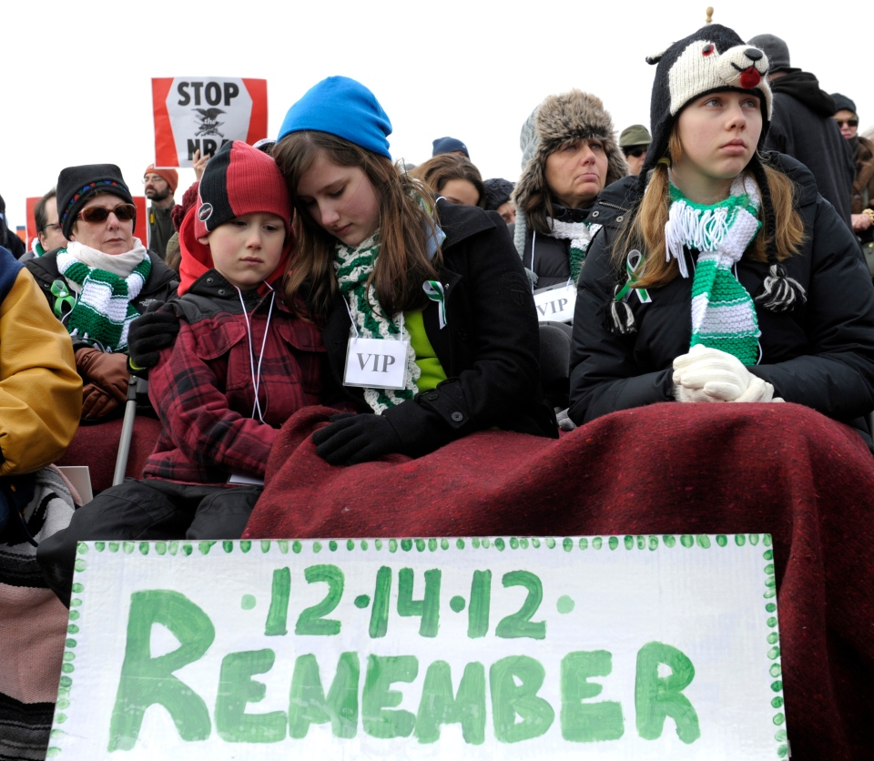 People listen to a speaker during a rally against gun violence near the Washington Monument in Washington, Thursday, Jan. 26, 2012. (AP / Susan Walsh)