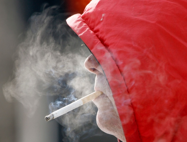 Experts debate penalities for smokers, obese