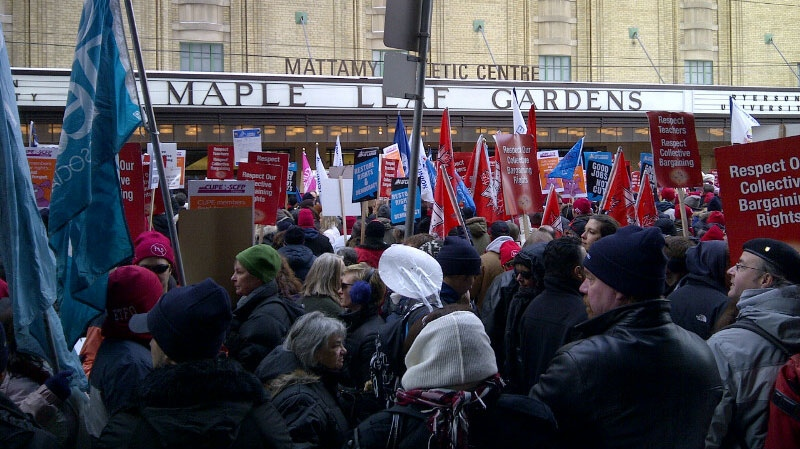A crowd of demonstrators protest outside of the Ontario Liberal Leadership convention in Toronto, Saturday, Jan. 26, 2013. (Merella Fernandez / CTV News)