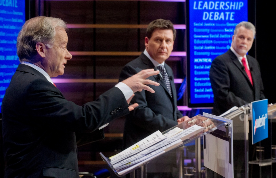 Raymond Bachand, left, speaks as Pierre Moreau, centre, and Philippe Couillard look on during their English language PLQ leaders debate in Montreal Saturday, January 26, 2013. (Graham Hughes / THE CANADIAN PRESS)
