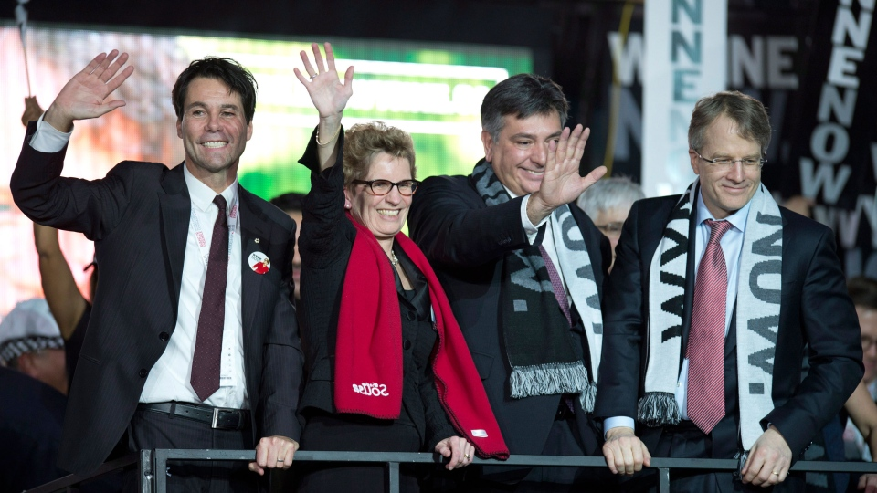 Ontario Liberal Party leadership candidate Kathleen Wynne celebrates with fellow candidates Eric Hoskins (left), Gerard Kennedy (right) and Charles Sousa after they gave her their support at the convention in Toronto on Saturday January 26, 2013. (Frank Gunn / THE CANADIAN PRESS)