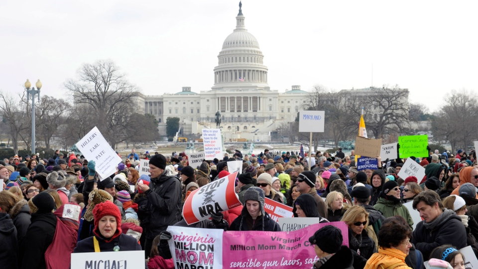 People walk from the U.S. Capitol to the Washington Monument in Washington on Saturday, Jan. 26, 2013. (AP / Susan Walsh)