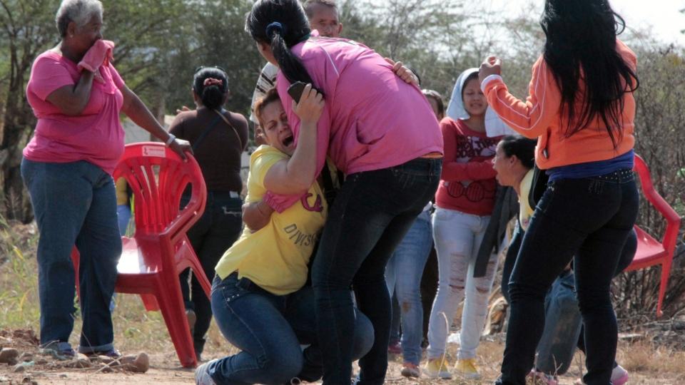 Relatives of inmates react outside the Uribana prison in Barquisimeto, Venezuela, Friday, Jan. 25, 2013. (AP Photo /Roger Varela / El Informador)