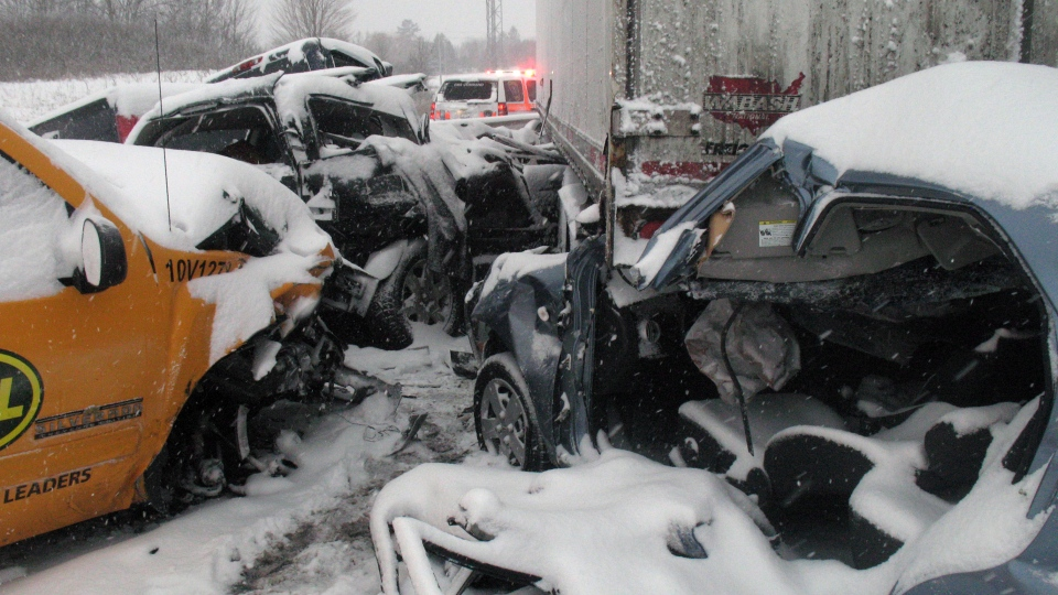 The scene of a multi-vehicle crash that closed the westbound lanes of Highway 401 at Newtonville Road between Port Hope and Clarington in Newcastle, Ont., on Friday, Jan. 25, 2013. (Doug Ives / THE CANADIAN PRESS)