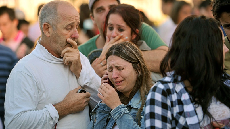 Relatives of victims react as they wait for news in fron of the Kiss nightclub in Santa Maria city, Brazil, Sunday, Jan. 27, 2013. (Ronald Mendes, Agencia RBS)