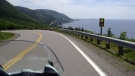 This July 13, 2010 photo shows the road along the eastern edge of Cape Breton Island during a 1,555-mile motorcycle tour along the Cabot Trail in Cape Breton, Nova Scotia. (AP Photo/Glenn Adams)