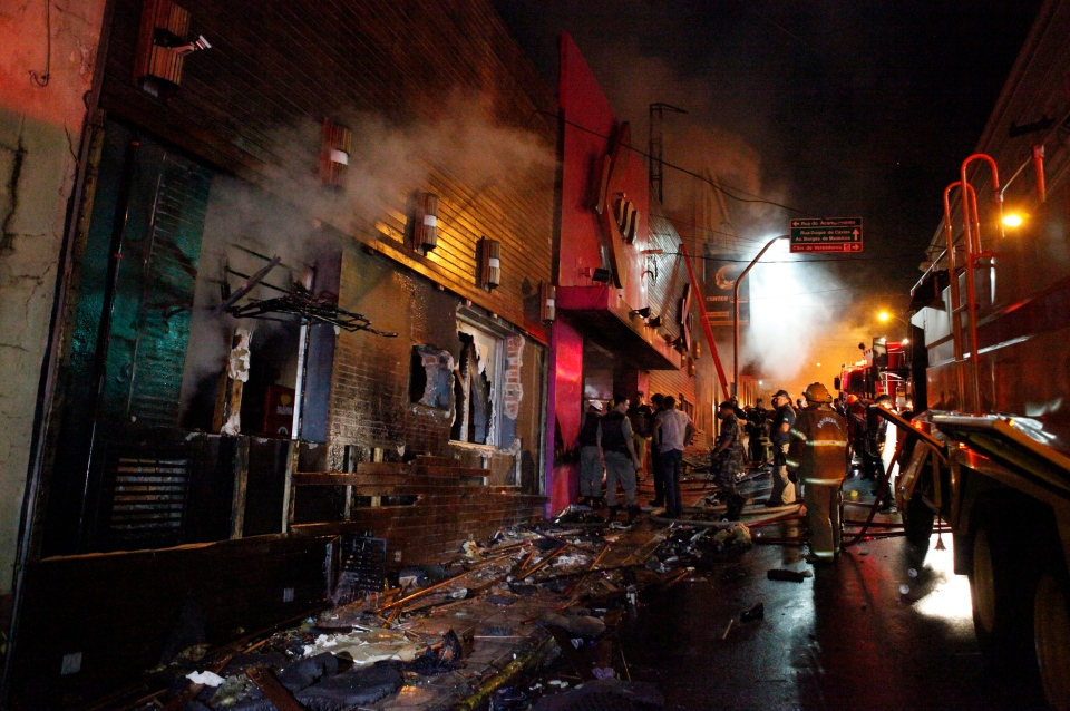 Firefighters work to douse a fire at the Kiss Club in Santa Maria city, Rio Grande do Sul state, Brazil, Sunday, Jan. 27, 2013. (AP / Agencia RBS)