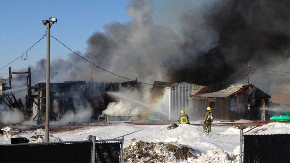 Firefighters say this blaze in Ste-Julie started when a dump truck caught fire. (Cosmo Santamaria / CTV News)