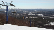 Skiers ride a chair lift to the top of Crabbe Mountain in New Brunswick on Feb. 3, 2010. (Kevin Bissett / THE CANADIAN PRESS)