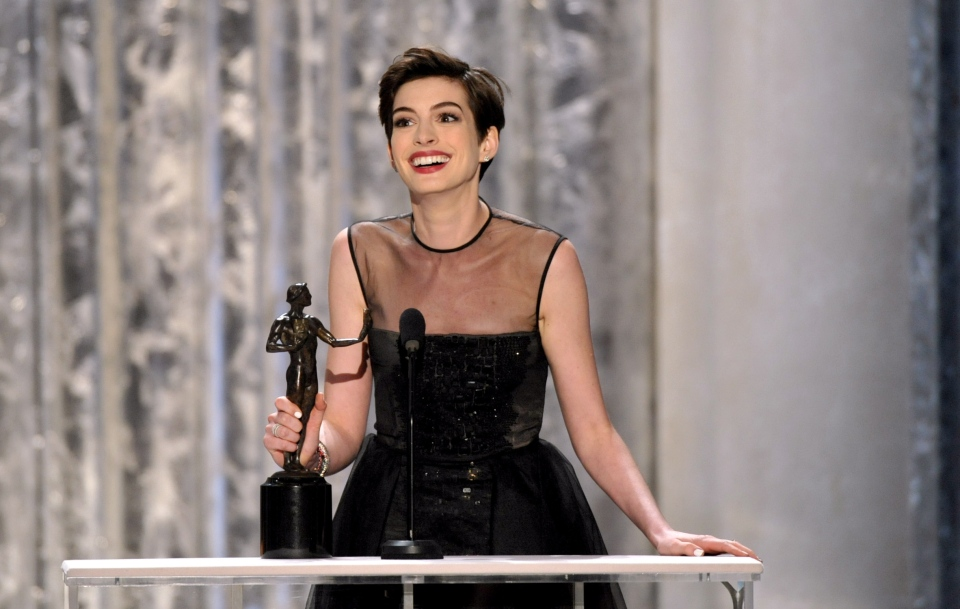 "Anne Hathaway accepts the award for outstanding female actor in a supporting role for ""Les Miserables"" at the 19th Annual Screen Actors Guild Awards at the Shrine Auditorium in Los Angeles on Sunday, Jan. 27, 2013. (Invision / John Shearer)"