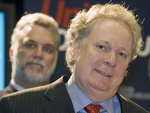 Quebec Liberal Leader Jean Charest speaks to reporters while campaigning in Laval, Que. on Monday. (CP / Ryan Remiorz)