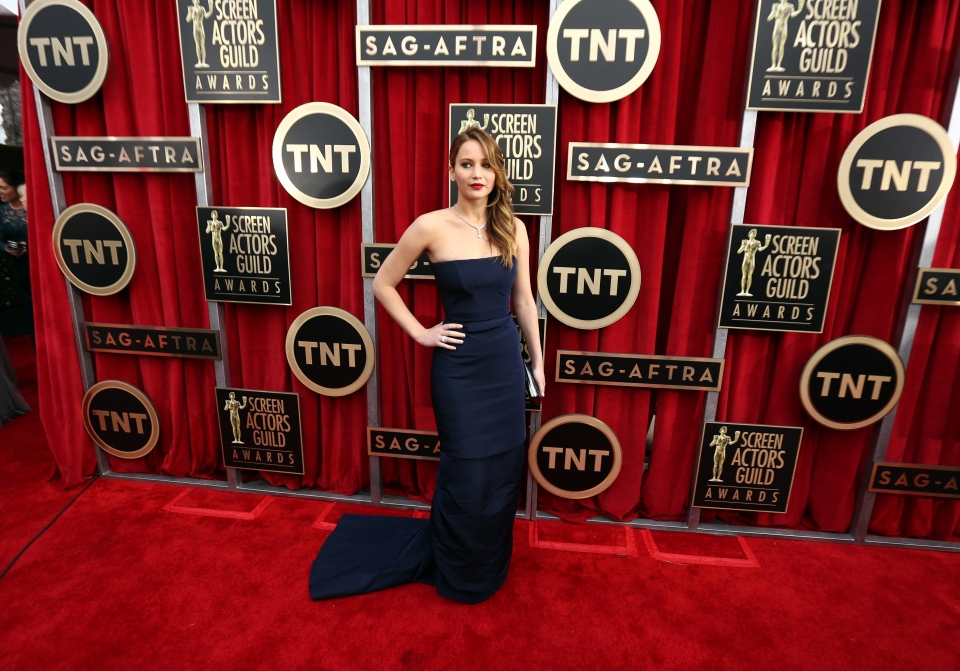 Actress Jennifer Lawrence arrives at the 19th Annual Screen Actors Guild Awards at the Shrine Auditorium in Los Angeles on Sunday Jan. 27, 2013. (AP / Invision / Matt Sayles)