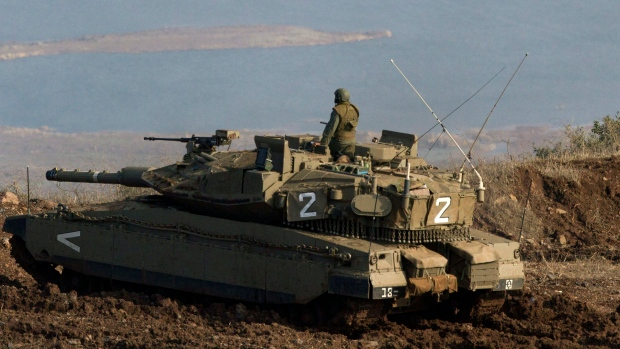 Israeli soldeir overlooking Syrian villiage