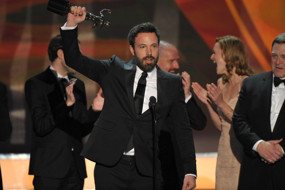 Ben Affleck, centre, and the cast of 'Argo' accept the award for outstanding cast in a motion picture at the 19th Annual Screen Actors Guild Awards at the Shrine Auditorium in Los Angeles on Sunday, Jan. 27, 2013. (John Shearer / Invision)