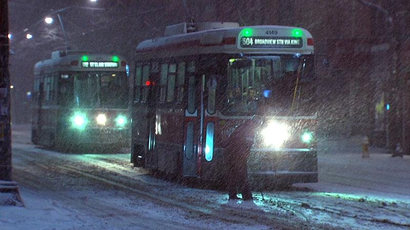 A man crosses the street as heavy snow falls in Toronto, Monday, Jan. 28, 2013.