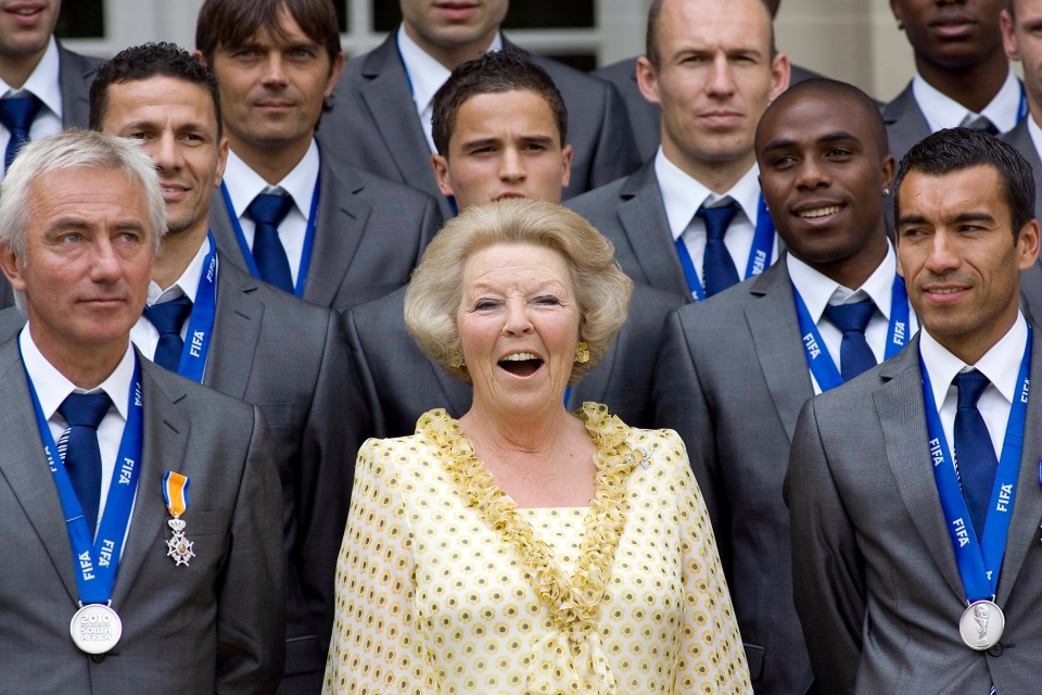 The Netherlands' World Cup team poses with Queen Beatrix, centre, in this 2010 file photo. (AP Photo/Rob Keeris)