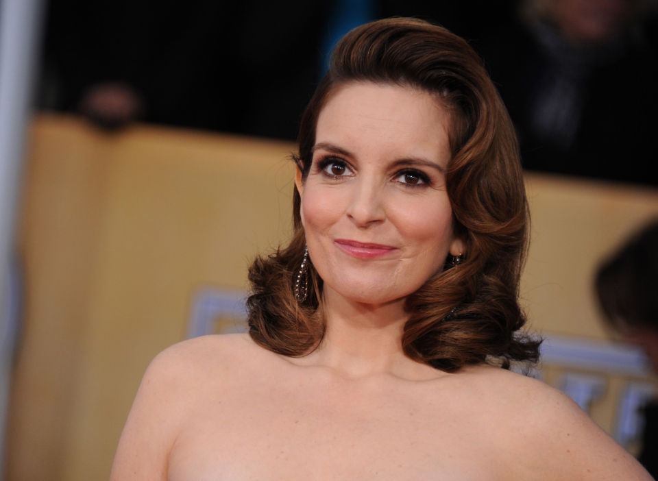 Tina Fey arrives at the 19th Annual Screen Actors Guild Awards at the Shrine Auditorium in Los Angeles on Jan. 27, 2013. (AP Photo/Invision/Jordan Strauss)