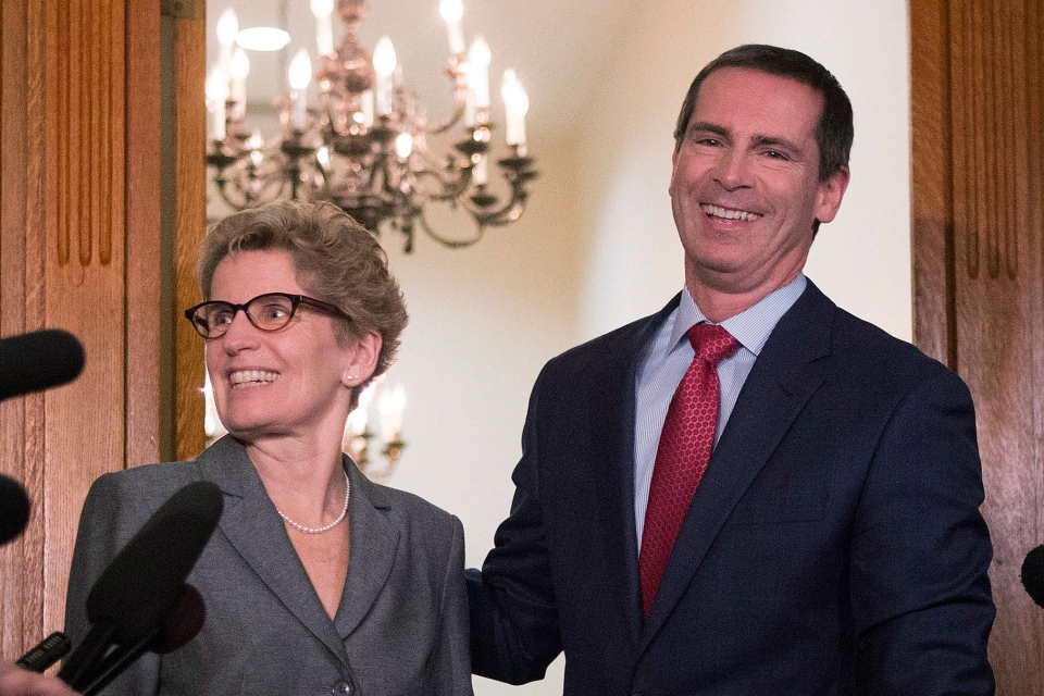Outgoing Ontario Premier Dalton McGuinty right and incoming premier Kathleen Wynne pose for media after a meeting at the Queen's Park in Toronto on Monday, Jan. 28, 2013. (Chris Young / THE CANADIAN PRESS)