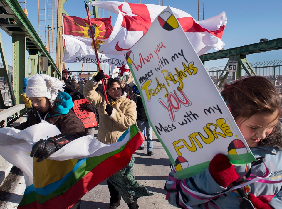 Demonstrators cross the Angus L. Macdonald bridge in Halifax on Monday, Jan. 28, 2013. The march is part of a wave of Idle No More protests across the country. (Andrew Vaughan / THE CANADIAN PRESS)