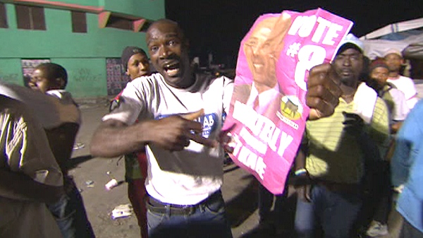 A supporter of presidential election candidate Michel Martelly is shown in this video image.