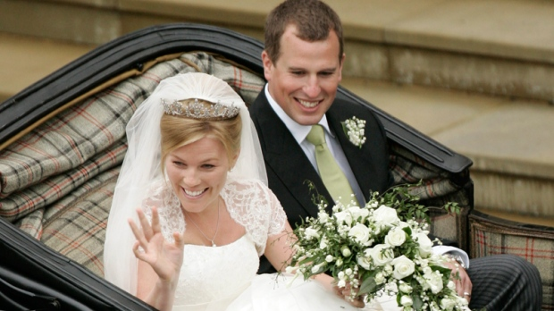 Peter Phillips, the eldest grandson of the Queen and Canadian Autumn Kelly leave St. George's Chapel in Windsor, England, after their marriage ceremony, Saturday, May 17, 2008. (AP / Sang Tan)