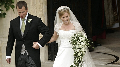 Peter Phillips, the eldest grandson of Queen Elizabeth II and Canadian Autumn Kelly leave St. George's Chapel in Windsor, England, after their marriage ceremony, Saturday, May 17, 2008. (AP / Sang Tan, Pool)