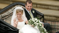 Peter Phillips, the eldest grandson of Queen Elizabeth II and Canadian Autumn Kelly leave St. George's Chapel in Windsor, England, after their marriage ceremony, Saturday, May 17, 2008. (AP / Sang Tan)