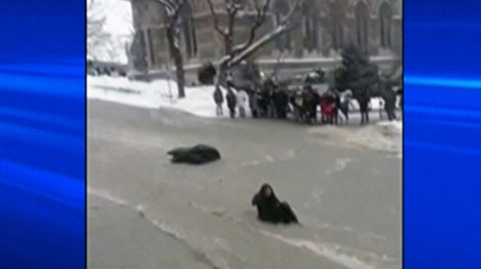A McGill student got swept up by the waters after attempting to cross a flooded street in Montreal on Monday, Jan. 28, 2013.