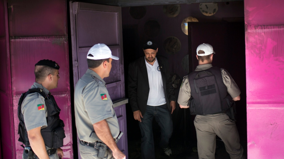 Police enter the Kiss nightclub the day after a fatal fire in Santa Maria, Brazil, Monday, Jan. 28, 2013. (AP Photo / Felipe Dana)