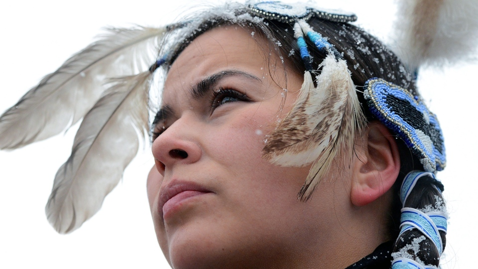 A native dancer looks on during an 'Idle No More' gathering on Parliament Hill in Ottawa on Monday, Jan. 28, 2013. (Sean Kilpatrick  / THE CANADIAN PRESS)
