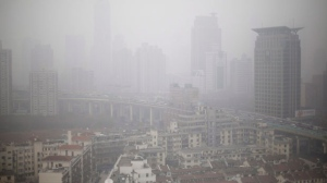 Houses and buildings are seen on a heavy haze in Shanghai, China, on Thursday, Jan. 24, 2013. (AP Photo/Eugene Hoshiko)