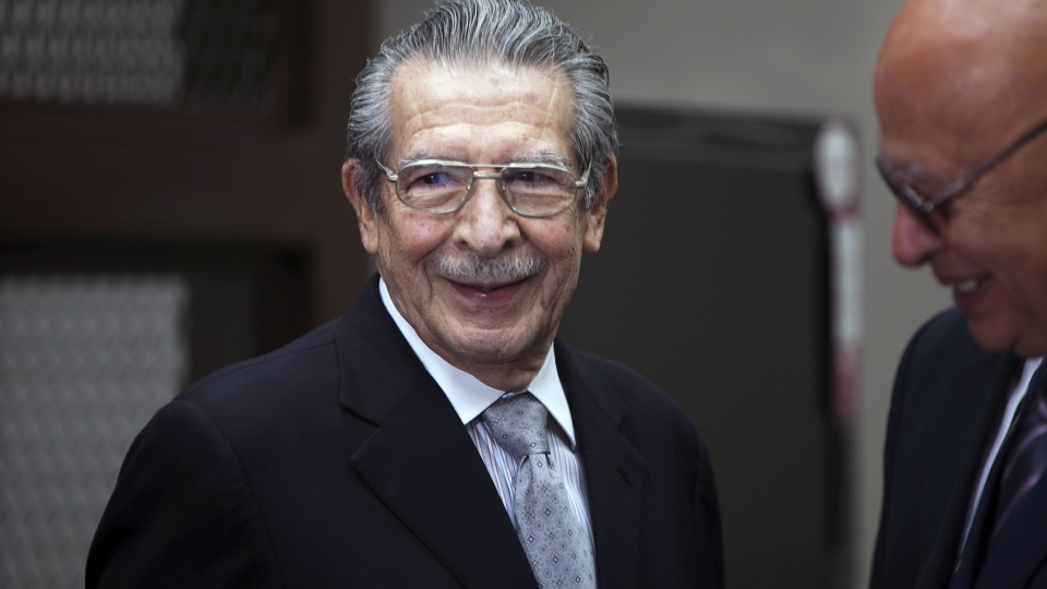 Guatemala's former dictator Jose Efrain Rios Montt, left, smiles as he attends his hearing in Guatemala City, Monday, Jan. 28, 2013. (AP Photo / Moises Castillo)