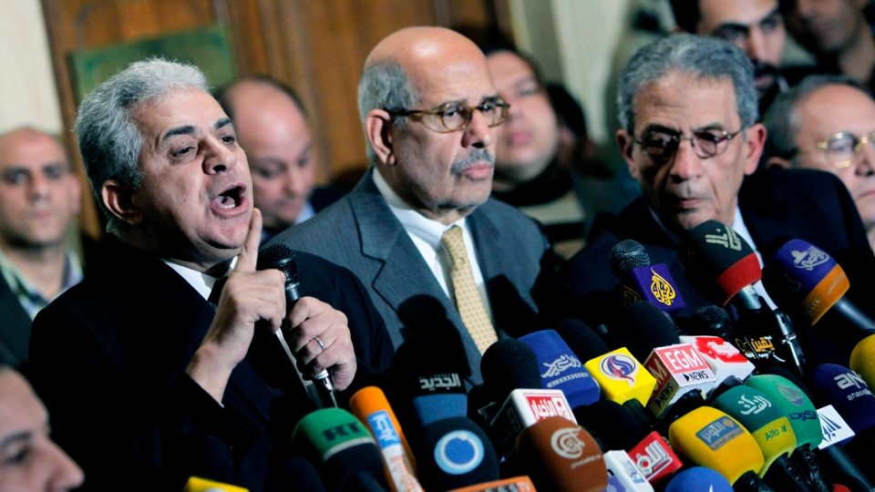 Former Egyptian presidential candidate, Hamdeen Sabahi, left, speaks during a press conference following the meeting of the National Salvation Front as former director of the U.N.'s nuclear agency and Nobel peace laureate, Mohamed El Baradei, center, and former Egyptian Foreign Minister and presidential candidate, Amr Moussa, right, listen in Cairo, Egypt, Monday, Jan. 28, 2013. (AP Photo / Amr Nabil)