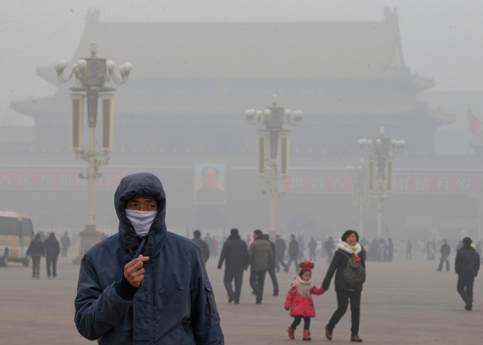 A man wears a mask on Tiananmen Square in thick haze in Beijing Tuesday, Jan. 29, 2013. (AP Photo/Ng Han Guan)