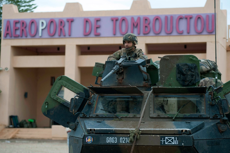 In this photo taken on Monday, Jan. 28, 2013, provided by the French Army Communications Audiovisual office (ECPAD) and released Tuesday Jan. 29, 2013, a French soldier guards the Timbuktu airport, in northern Mali. (AP / Arnaud Roine; EMA-ECPAD)