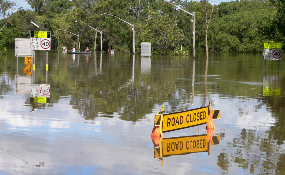 This photo supplied by NSW State Emergency Service, shows the Bruxner Highway covered with floodwaters caused by torrential rains in Lismore, northern New South Wales, Australia Tuesday, Jan. 29, 2013. (NSW State Emergency Service /  Samantha Cantwell)