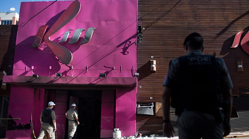 Police officers enter the Kiss nightclub in Santa Maria city, Rio Grande do Sul state, Brazil, Monday, Jan. 28, 2013. (AP / Felipe Dana)