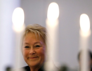 Quebec Premier Pauline Marois smiles through candles during a luncheon after giving a speech to the Canadian-UK Chamber of Commerce in London, Monday, Jan. 28, 2013. (AP / Kirsty Wigglesworth)