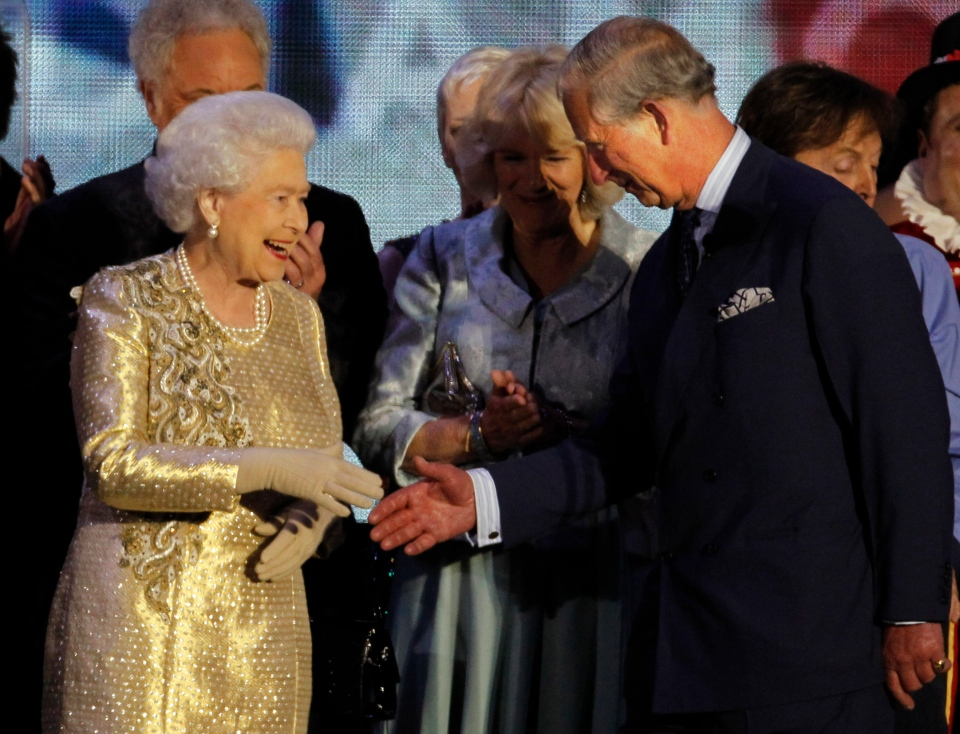 In this Monday, June 4, 2012 file photo Britain's Queen Elizabeth II shakes the hand of her son Prince Charles at the end of the Queen's Jubilee Concert in front of Buckingham Palace, London. (AP / Joel Ryan)