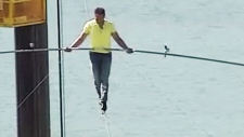 Nik Wallenda walks on a wire