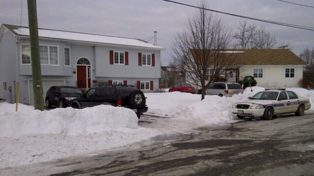 Police have surrounded a home outside New Maryland after a woman was shot early Tuesday in a Fredericton neighbourhood.
