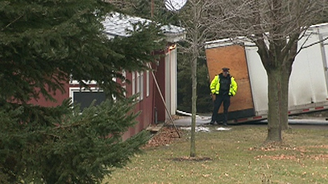 "Ontario Provincial Police investigate the scene of a ""savage attack"" that left a 73-year-old Ancaster, Ont., woman dead."