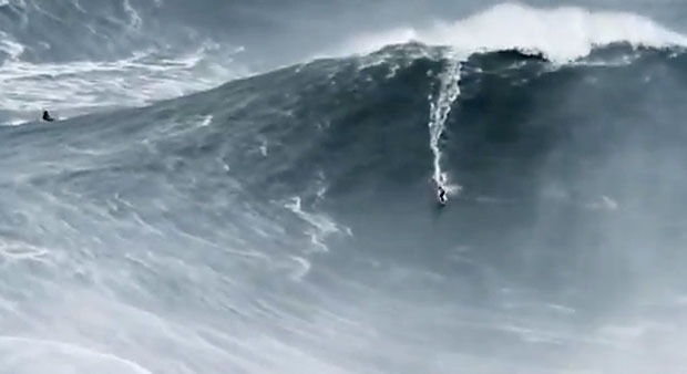 In this image taken from YouTube, big-wave surfer Garrett McNamara is shown riding a massive wave in Nazare, Portugal.