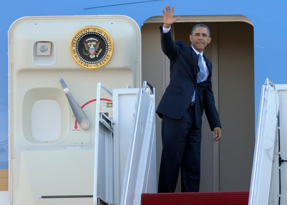 U.S. President Barack Obama waves from the top of the steps of Air Force One at Andrews Air Force Base in Md., Tuesday, Jan. 29, 2013. Obama is traveling to Las Vegas to deliver a speech on immigration. (AP Photo/Susan Walsh)