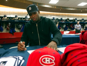 Montreal Canadiens defenceman P.K. Subban autographs souveniers in this 2011 file photo. (Ryan Remiorz/THE CANADIAN PRESS)